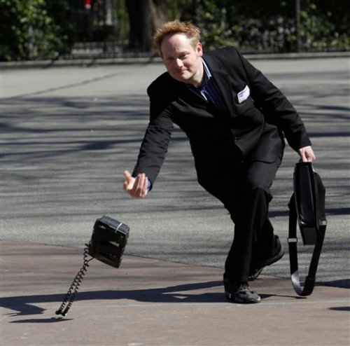 Christopher Dawes tosses an office phone during the Unemployment Olympics in New York, Tuesday, March 31, 2009. (AP Photo/Seth Wenig)